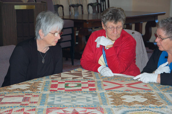 Inspecting The Sykes Quilt