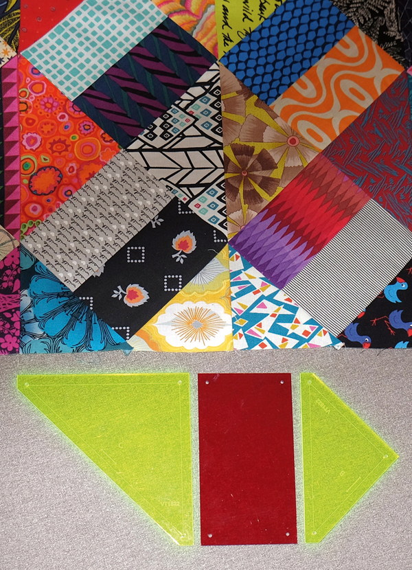 Kaniva Templates With Portionof A Scrappy Pieced Quilt